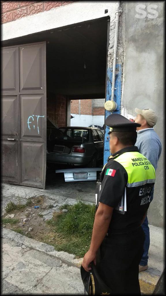 Asegura SS predio con vehículos con reporte de robo y detiene a presunto responsable